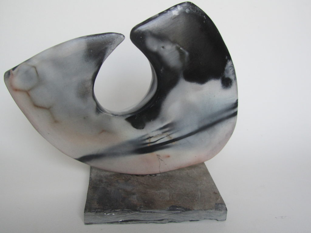 Smoke-fired form on slate
